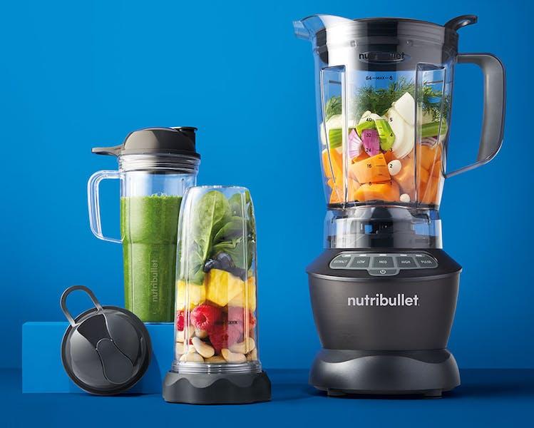 NutriBullet Blender Combo with fruits and vegetables on blue background.