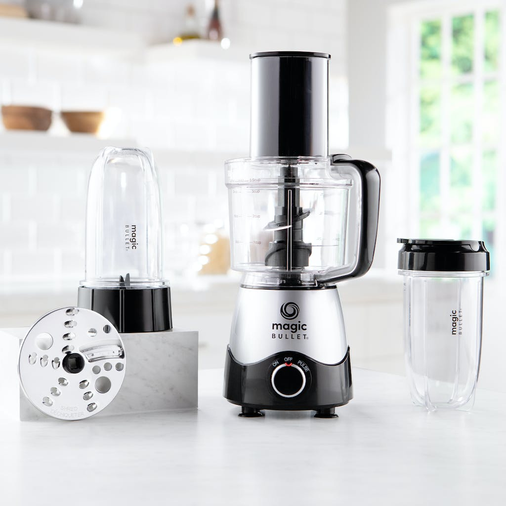 magic bullet kitchen express with cups, blades, and other accessories