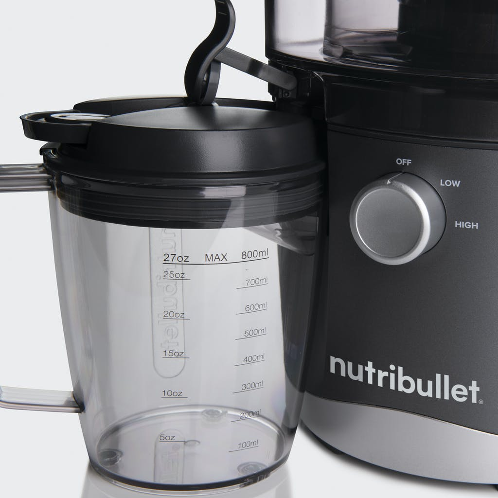 close up of nutribullet juicer cup with lid and juicer dial