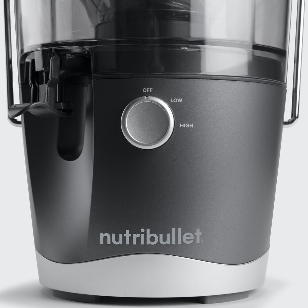 close up of nutribullet juicer multi-speed dial and pitcher