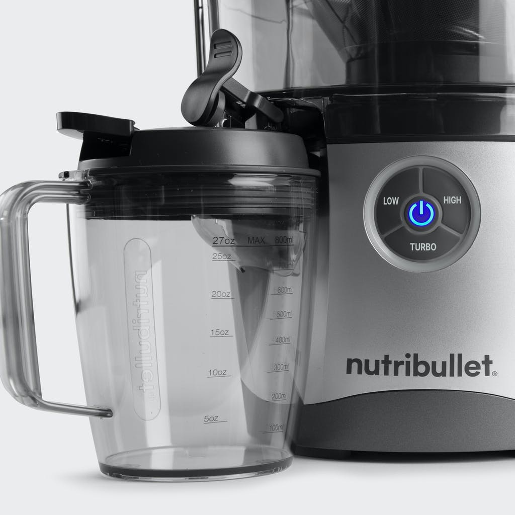 close up of nutribullet juicer pro cup with lid and multi-speed control panel