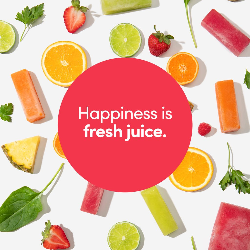 """happiness is fresh juice"" slogan in front of fruit flat lay with strawberries, citrus fruits, and leafy greens"