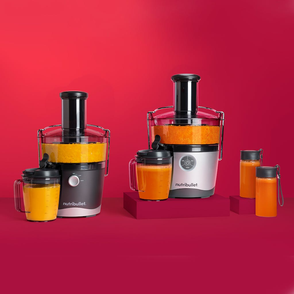 fresh yellow and orange fruit juices made in NutriBullet Juicer