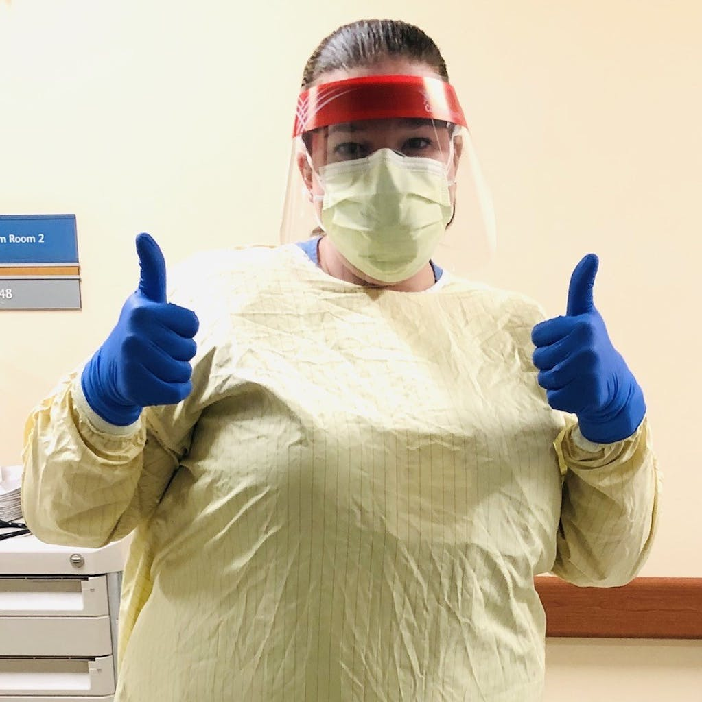 rachel white an emergency medicine physician from Indiana with thumbs up wearing PPE