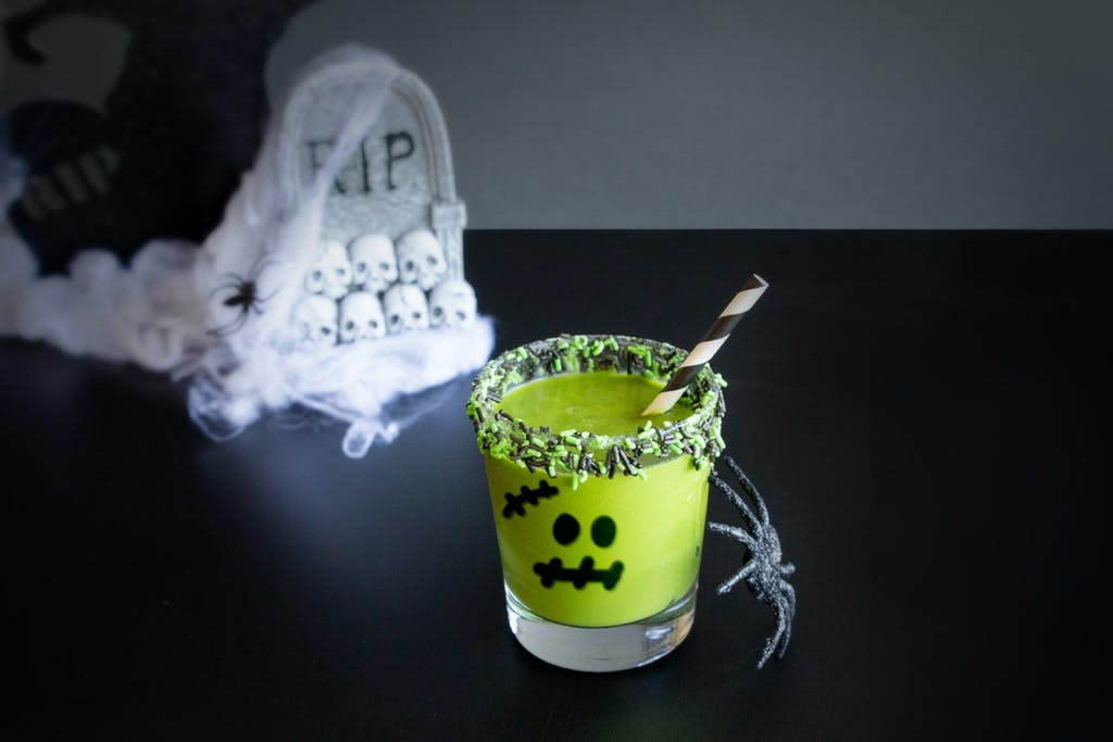 green smoothie with ghoul face for halloween