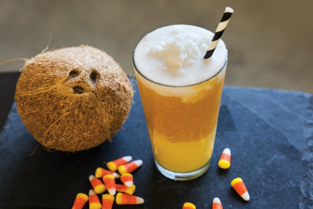 candy corn smoothie with yellow, orange, and white layers