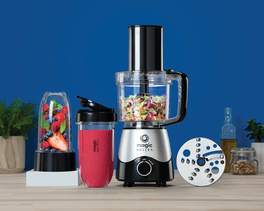 magic bullet Kitchen Express with fruits and vegetables on blue background.