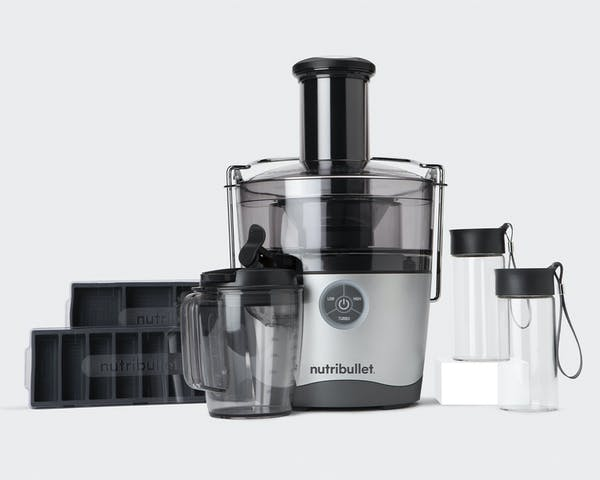 NutriBullet Juicer Pro and accessories on gray background